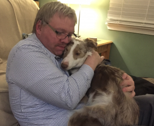 Image: Dan hugging Charlie
